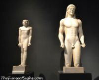 From the National Archaeological Museum in Athens, Kouros (right), Greek, about 520-500 BC, marble.