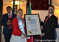 Brigit Cordero and Consul Gustavo Sancho hold the declaration of 'Dia del Costarricense'
